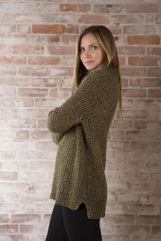 An easy to knit and even easier to wear top down pullover with a turtleneck, rib details and allover texture.