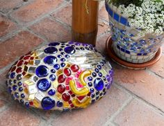 All over glass mosaic design on a medium size rock, just to accent the garden.