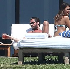 Relaxing: Reality star Scott Disick was seen drinking what appeared to be alcohol as he lo...