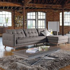 Our Marseille designer sofa offers a soft elegant look with its contrasting leather and walnut. The slightly splayed legs of the platform base has a mild retro feel which when combined with the stitch detail on the sides and cushions give it a contemporary look. The linen/cotton mix fabric offers both softness and durability. The covers on are the cushions are fixed. The range is offered in a corner, three or two seater sofa as well as an armchair and a smart footstool.