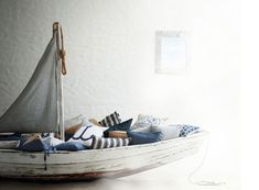 maybe oneday, when babe is an older boy, I can make him a sailboat bed. So everynight he can sail away to dreamland.