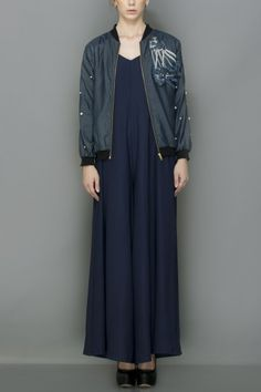 Whirl flared jumpsuit gown teamed with an embroidered bomber jacket