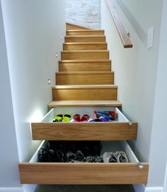 shoe storage built into stairs. this would save so much space in my closet!!