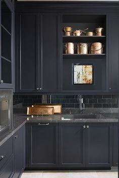 Black kitchen with copper accessories | Knowles Design Studio