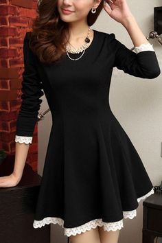 Pretty black fit and flare dress with 3/4 sleeves and white lace details