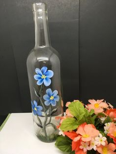 Items similar to Bottles Hand Painted Vintage White Daisies and Blue Flowers Wedding Table Decor Centerpiece Unique Gift Idea Home Decor Country Decor Gift on Etsy Painted Glass Bottles, Lighted Wine Bottles, Painted Jars, Hand Painted, Decorated Bottles, Wine Glass, Crafts With Glass Jars, Glass Bottle Crafts, Wine Bottle Art