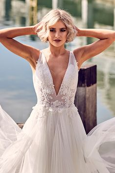 Stunning v-neck wedding dress from the Emanuella by Peter Trends Bridal collection.