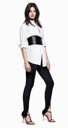 White pleated long blouse with black pants, suede heels, and wide waist belt. #HMFashionWeeks