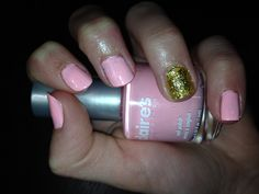 Pink with one gold nail How to: I didn't have gold glitter nail poloish, so I used one of my old clear nail polises, dumped glitter in there, stirred around and done! Cheap and easy, works very well! I used two coats.
