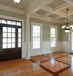 702 Hollywood: The Art of Wood Trim And Crown Moulding.  Love the look to define rooms.