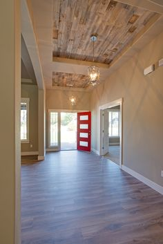 Cannot get enough of this stunning home entrance! From the bright red door to the Stikwood ceiling accent behind each entry chandelier! P.C. Bill Johnson #GNWhomes