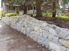 Completed drystone retaining wall in Cambridge ON Building A Retaining Wall, Retaining Walls, Aesthetic Look, Dry Stone, Landscape Services, Concrete Blocks, Landscape Design, Sidewalk, Exterior