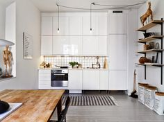 Theres something about this Gothenburg apartment which really stands out. The high ceilings and...