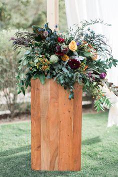 Colorful Floral Arrangement on Pedestal | Photo: Lucas Rossi Photography.