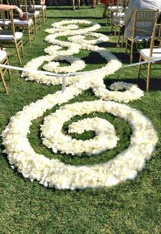 Possibly this rose petal aisle instead of aisle flowers?