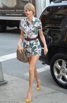 Taylor Swift wore a tropical print Reformation romper, a Dolce & Gabbana tote and Gucci suede pumps http://dailym.ai/1mbQlmd