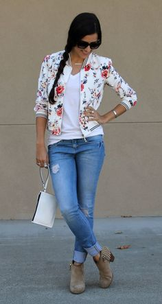 Love, Love, Love this piece! Especially the striped accents mixed with the floral. Fun twist to a traditional bomber jacket.