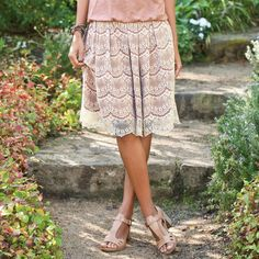 GAIA LACE SKIRT -- A terracotta lining under ivory lace lends earthy luxury to a unique skirt with a bold antique gold side zipper. Nylon
