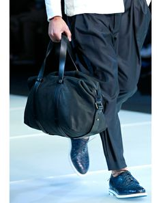 "Giorgio Armani ""The black leather duffle bag: great size and shape.""—Ted Stafford, GQ European market editor"