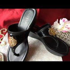 Guess  black sandals size 7 Black Guess sandal with gold logo. The Guess heel logo is an little faded on the right sandal but other than that these look in real good condition. Let me know if you have questions. Thanks!! Guess Shoes Sandals