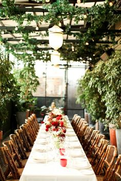 long plank table stored in tool shed for family dining under trellis.. what an idea!