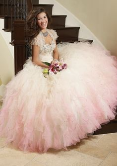 Vizcaya Quinceañera dress by Mori Lee. Style #88013. Description: Beaded, ruffled tulle, corset back, and matching bolero. Available in both solid and two tone colors. Solid colors available: peacock, cerise, and white. Two tone colors available: Champagne/blush, twilight, sunset, pink fusion, and yellow fusion.