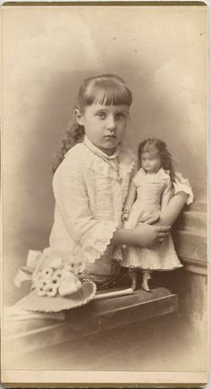 Antique cabinet photo of young girl with a Wax Doll by R. Furman, Rochester, NY, circa 1900.