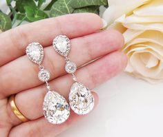 Wedding Jewelry Bridal Earrings Bridesmaid Earrings Dangle Earrings Clear White Swarovski Crystal and Cubic Zirconia Tear drop Earrings. $36.00, via Etsy.