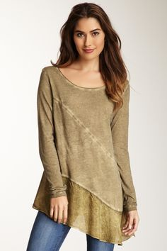 Long sleeve scoop neck tunic top with bottom ruffle - this would be flattering on everyone.