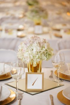 White and gold wedding centerpiece idea - white hydrangeas in gold vases {Stefania Bowler Photography}