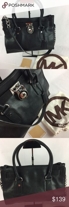 """Michael Kors Hamilton Leather Black Satchel Condition: New. No tag but includes original Care Card and Dust Bag. Exterior: grade A, interior B, small marks on bottom of liner.   This satchel features luxurious glazed, luggage black leather with MK signature logo hardware. Double straps and a chain link shoulder strap pull this chic look together. * Construction: Leather * Model: 30T01HMS3L * Double and longer strap for shoulder wear * L 12"""", H 9"""" W 4"""" * Drop: 4 inch drop   Thank you for your…"""