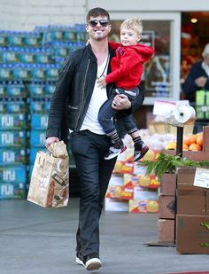 Daddy Robin Thicke, in modernized aviators, was all smiles during a grocery shopping outing with his adorable son Julian in tow!
