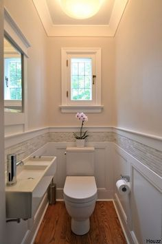 Stunning Bathroom Backsplash Ideas | Bathroom Remodel Like the tile above the wainscoting.