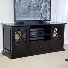 Belham Living Hampton 55 inch TV Stand - Black - Tired of mass-marketed furniture that you can find at any store in town? Then you're sure to love our Hampton 55-inch TV Stand - Black. It's exclusive...