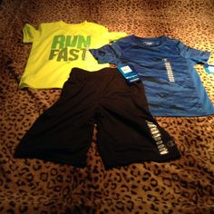 Boys 3 piece athletic wear set 5/6 Champion brand  (3) piece set for your handsome son! Neon yellow  / vibrant blue shirts paired with black shorts . Very modern and sporty active wear. Champion Matching Sets