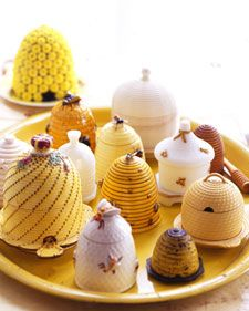 Symbolic of industriousness and harmony, bees are the perfect motif to decorate humble domestic objects, especially  those for the kitchen, the bustling hive of a home. These are not rare, special-occasion-only pieces, but commonplace treasures, including pitchers, plates, and even pincushions and coin banks.