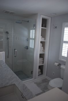 White carrera marble floors and vanity tip, built in niche, Grohe Geneva fixtures, ADKO 3/4 x 3/4 carrera marble floor in shower w/gray grout, 4 x 8 Jeffrey Court iceberg marble polished floor tiles from Cap.9-Pietra Opus II series w/gray grout, white subway tiles w/white grout