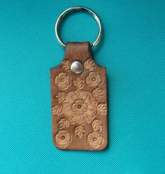 Stamped/Tooled Leather Floral Design Brown Key Ring by shaterra on Etsy https://www.etsy.com/listing/113913622/stampedtooled-leather-floral-design