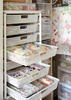 Outfit a closet for fabric storage. A wire-drawer storage rack organizes works-in-progress and precut fabrics. Built in cubbies hold plastic bins full of sorted fabric. And hang finished quilt tops waiting for quilting from clothes hangers. Sewing Room Storage, Sewing Room Organization, My Sewing Room, Craft Room Storage, Fabric Storage, Sewing Rooms, Drawer Storage, Storage Rack, Craft Rooms
