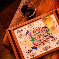 This teak Wood tray with intricate Mithila work has a beauty in its detailing.  Shop at: http://ift.tt/1ORGEZm  #inkgrid #homedecor #ecommerce #like #follow #startup #homedecorideas #kitchenware #art #likeforlike #pattern by inkgrid.decor