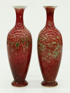 Pair of Chinese Peachbloom Porcelain Vases 9.25''x3'' Each. Fine mottled sang de boeuf glazes with green splashes. Six character blue underglaze Kangxi mark and possibly period.