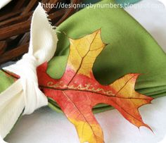 Use a gold marker to hand-write names on dried or fresh fall leaves for place cards from Designing by Numbers.