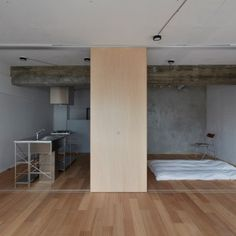 FrontOfficeTokyo+strips+back+small+Tokyo+apartment+by+pulling+down+walls