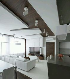 Interior Luxury White Living Area Decoration With Leather Sofa And Brown Cushions Also Dining Table Grey Laminate Kitchen Bars