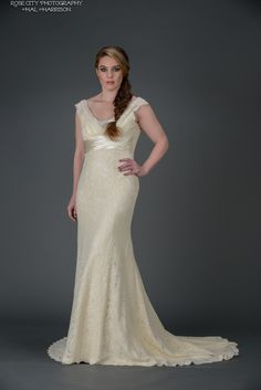 """Isabella"" gown made of vintage-inspired cotton lace with silk charmeuse detail.  Features a small train and deep V back."