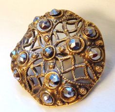 ANTIQUE DOMED BRASS PIERCED BUTTON WITH CUT STEELS  see description