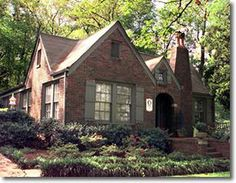 Brick house with taupe trim and windows.