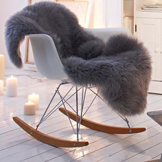 With dark wood base and silver sheepskin for the living room.