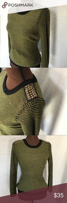 Anthro Green Sweater Brass Studded Shoulders This sweater from Pink Rose/Anthropologie comes in an olive green with loose knit sleeves and fun brass studs on the shoulder. The neckline, cuffs and bottom hem are trimmed in black which contrasts well against the green. The sweater should be hand washed in cold water and laid flat to dry. EUC, this is in great shape with no stains or flaws.    ✅20% Off Bundles   ✅Questions Welcomed   ✅Reasonable Offers   ⛔️Trades   ⛔️Offline Transactions…