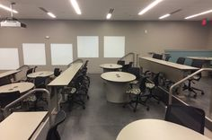 Indiana-Hine Hall 118 is designed to support active learning in large lecture-hall classrooms. All seats have power to support bring-your-own devices. Students can easily group for collaboration because of the variety of work settings, which includes rows and round-tables, plus the whiteboard space around the perimeter the room. All students can easily share content via their mobile device to the large projectors in the front of the classroom using Mersive Solstice.